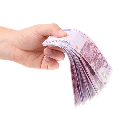 Hands holding 500 euros banknotes. Isolated on a white background photo