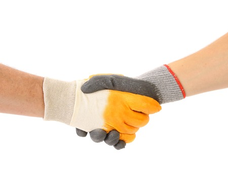 Two hands in gloves of hand shake. Isolated on a white background photo