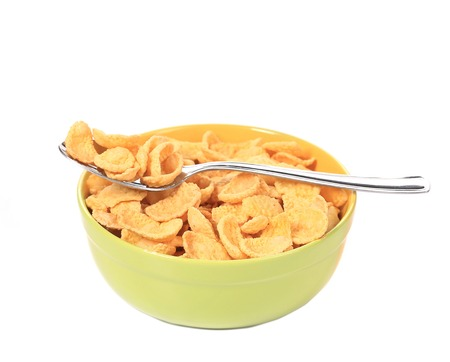 sugarcoated: Bowl of sugar-coated corn flakes. Isolated on a white background.