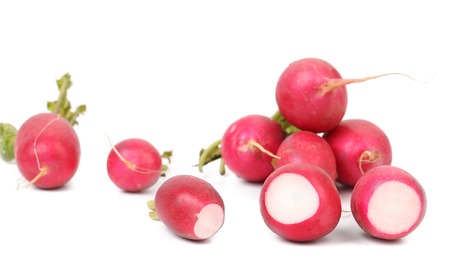 red skinned: Fresh radishes. Isolated on a white background. Stock Photo