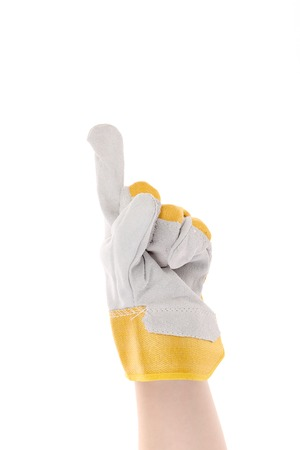 Hand in gloves shows one. Isolated on a white background. photo