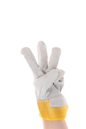 Hand in gloves shows three. Isolated on a white background. photo