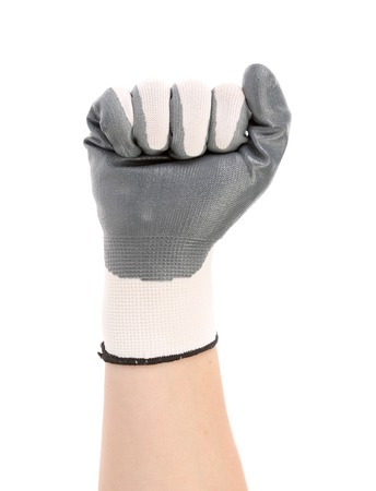 Hand in gloves in fist. Isolated on a white background. photo