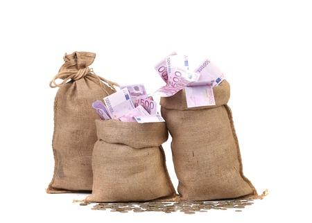 Three full sacks of euro bills. Isolated on a white background.