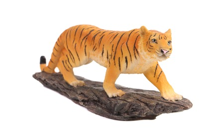 Plastic tiger figurine. Isolated on a white background. photo