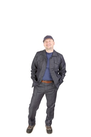 Smiling worker in work wear. Isolated on a white background. Stock Photo
