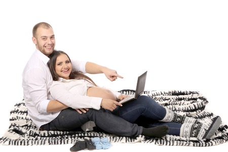 Happy family. Man and pregnant woman. Isolated on a white background. photo