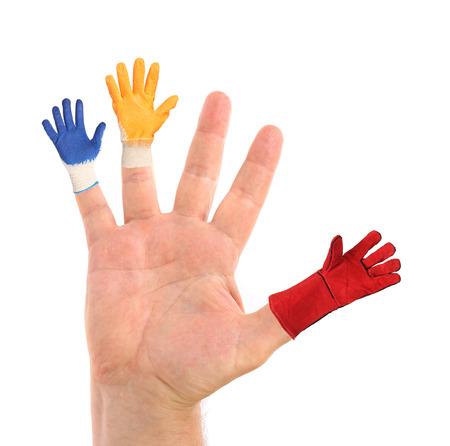 Small gloves wearing from hand. Isolated on a white background. photo