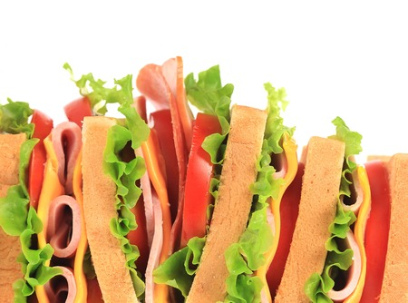 Big sandwich with fresh vegetables. Place for text. Whole background. photo