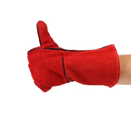 Heavy-duty red glove. Isolated on a white background. photo