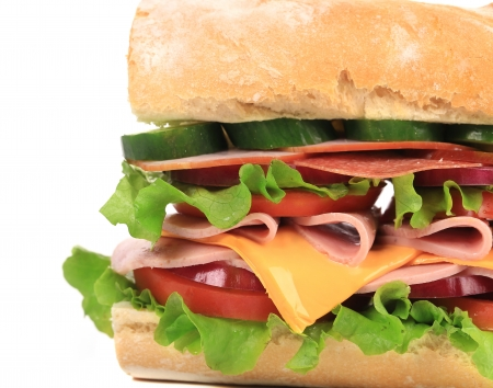 Appetizing sandwich with cheese and sausage. Whole background. photo