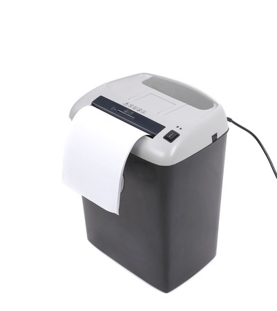 Close up of paper shredder. Isolated on a white . photo