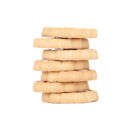 Stacks of cookies. Isolated on a white . photo
