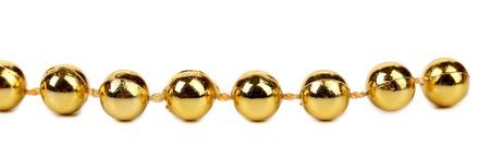 horisontal: Decorative golden beads. Horisontal.