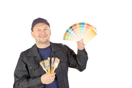 Worker with color samples and brushes. Isolated on a white background. photo