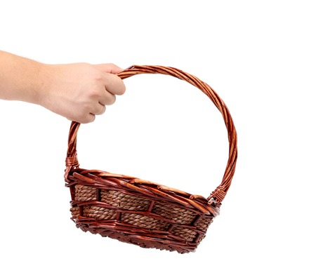 Vintage weave wicker basket. Isolated on a white background. photo