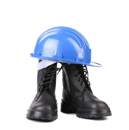 steel toe boots: Hard hat and working boots. Isolated on a white background. Stock Photo