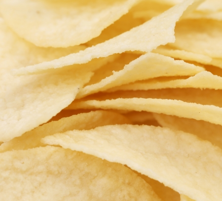 unhealthful: Background of potato chips. Close up. Whole background.