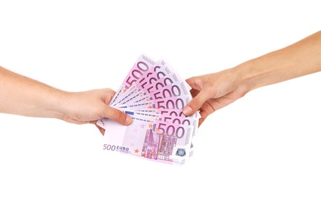 Hand holding five hundreds euro banknotes. Isolated on a white background. Archivio Fotografico