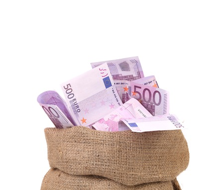 Bag with many euro banknotes. Isolated on a white background. photo