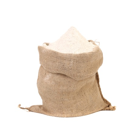 Sack with wheat flour. Isolated on a white background. Archivio Fotografico