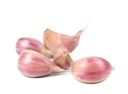 Fresh garlic whole and cloves. Isolated on a white background. Stock Photo