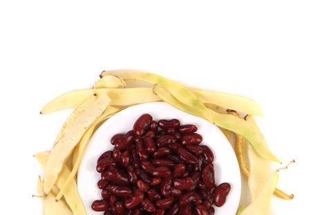 Composition of yellow pods and red beans. Isolated on a white background Stock Photo - 24490431