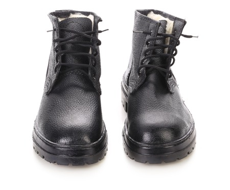 Pair of black leather boots. Isolated on a white background. photo
