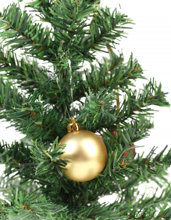 Christmas tree and yellow toy. Isolated on a white background. photo