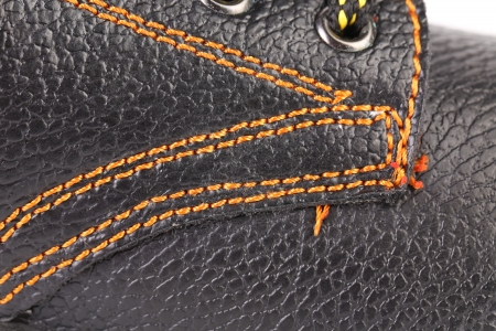 shoestrings: Shoe stiches on boot close up. Whole background.