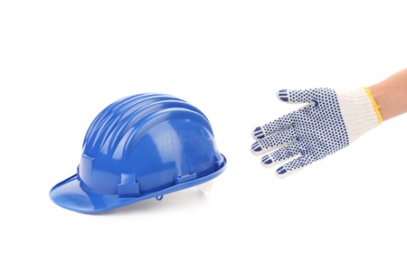 Hand holding blue hard hat. Isolated on white background. photo
