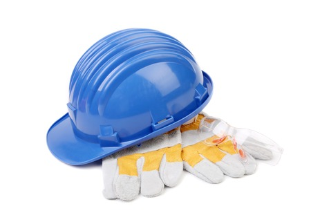 Hard hat gloves and glasses. Isolated on a white background. photo