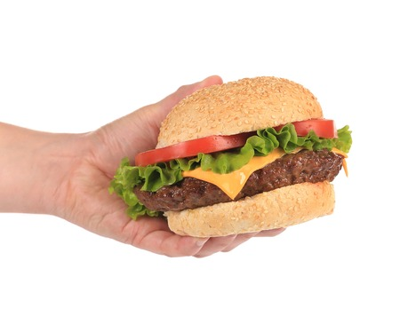 Big appetizing hamburger in hand  Isolated on a white background  photo