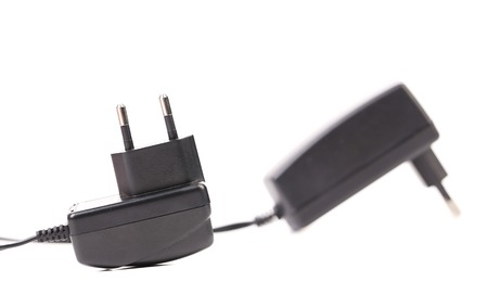 Two electric power adapters. Close up. Isolated on a white background. photo