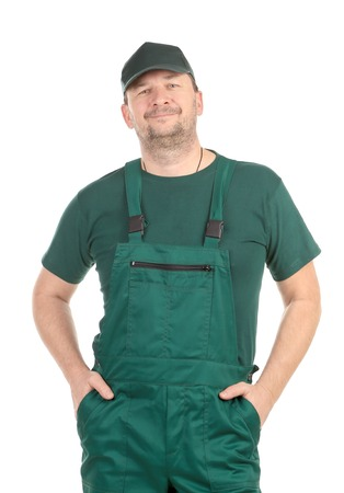 Confident worker in overalls. Isolated on a white background.