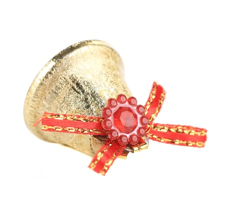 Christmas jingle bell with red ribbon. Isolated on a white background. photo