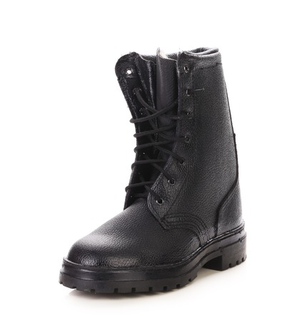 Leather winter black boot. Isolated on a white background. photo