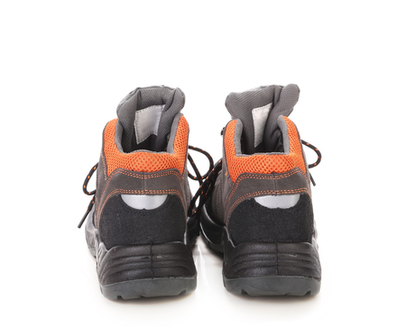 inset: Black mans boots with orange inset. Isolated on a white background. Stock Photo