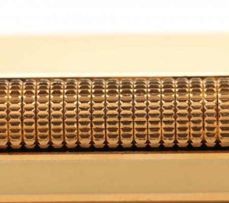 gas lighter: Metal flint golden on gas lighter Stock Photo
