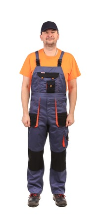 Worker wearing overalls. Isolated on a white background.