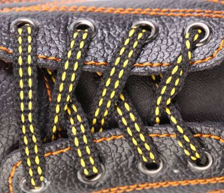 shoestrings: Shoe laces close up with orange stitches