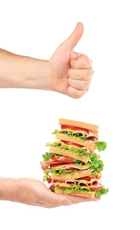 Tasty sandwich in hands. Isolated on a white background. photo