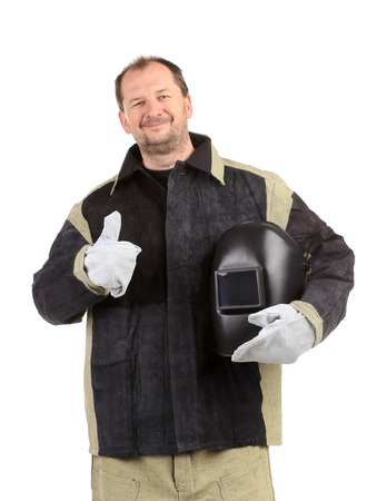Welder with mask in hands. Isolated on a white background. photo