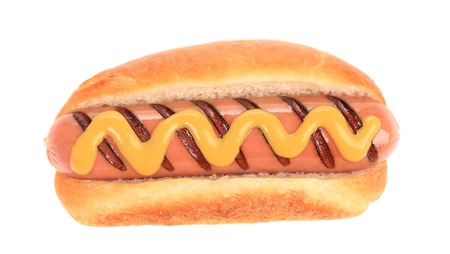Hotdog with mustard. Isolated on a white background. photo