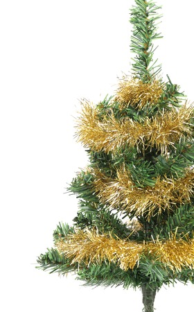 Christmas tree wrapped in tinsel. Whole background. photo