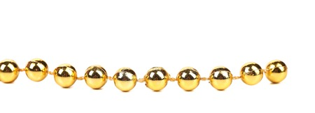 ball and chain: Decorative golden beads. Horisontal. Isolated on a white background.