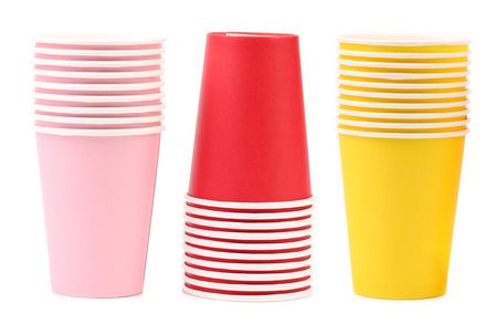 Three different color cups in a row.  Isolated on white background photo