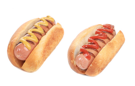 Hotdogs with mustard and ketchup. Isolated on a white background. photo