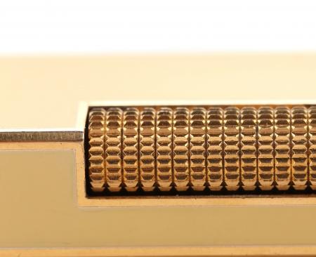 gas lighter: Metal flint golden on gas lighter  Whole background