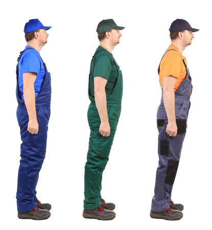 resistant: Three workers wich are looking at the same direction